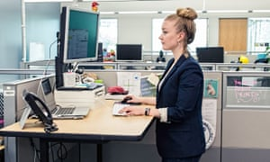 A standing desk is one of the ways firms can boost employees' health.