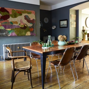 Table talk: the dining-room table, with Les Arc leather-backed chairs by Charlotte Perriand.