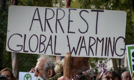 A protester holds a sign at climate demonstration in London last month.