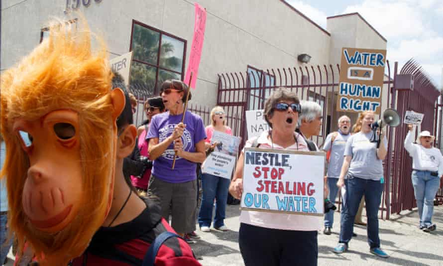 Demonstrators protest against Nestle water bottling operations in California. According to news reports, Nestle, which operates five bottling plants in California, uses 244m gallons of water annually. Reports also said that its state water permit expired 27 years ago.