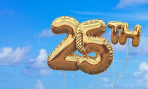 Gold number 25 foil birthday balloons against a bright blue summer sky