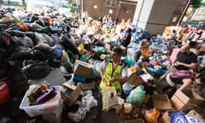 Mountains of food and clothing donated to the many people who have lost everything in the Grenfell Tower fire