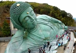 Sasaguri, JapanTemple parishioners clean up the Reclining Buddha at the Nanzoin temple