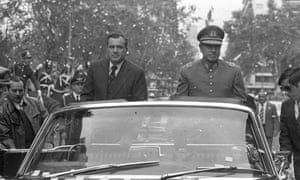 Former Chilean dictator Augusto Pinochet, right, in Uruguay, in 1976