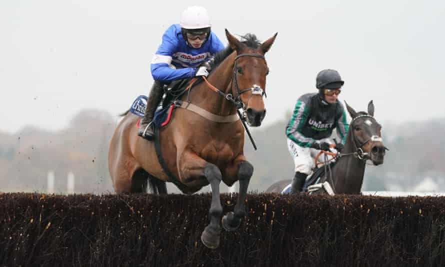 Cyrname ridden by Harry Cobden clears the final fence on his way to victory over Altior (right).