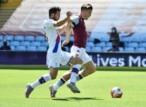 Aston Villa's Jack Grealish in action with Crystal Palace's James McArthur.