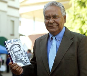 Darby McCarthy holds a copy of his autobiography Against All Odds at the launch in Brisbane in 2004.