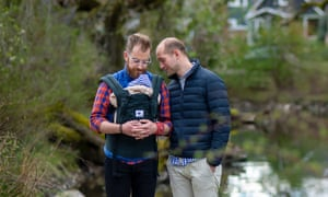 James, left, and Rob pose for a portrait with their son in Portland, Oregon