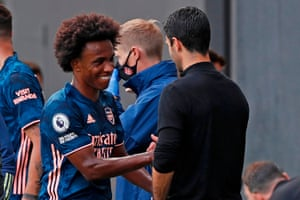 Arsenal's Willian (left) looks pleased with his performance on his Premier League debut for the Gunners as he shakes hands with manager Mikel Arteta.