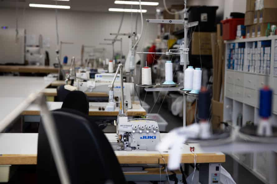 Empty sewing stations at The Fashion Production Company.