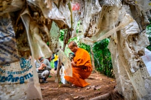 Khung Bang Kachao forest, Thailand: A Buddhist monk helps to clear up the tons of plastic waste carried by the current