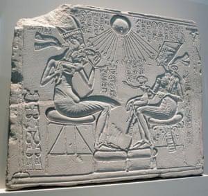 Egyptian relief depicting Pharaoh Akhenaten and Nefertiti with their children. ca. 1345 BC