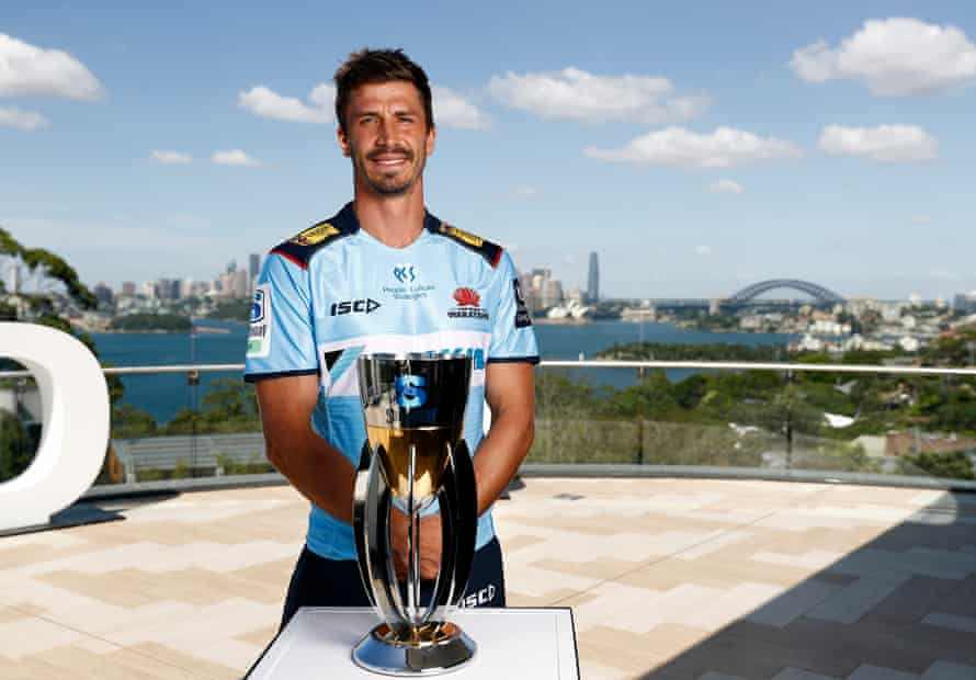 NSW Waratahs captain Jake Gordon with the Super Rugby AU trophy.