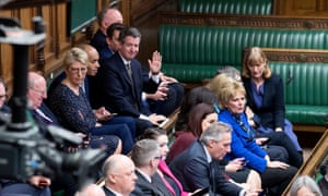 Recently resigned Conservative and Labour MPs who have joined each other in the newly created Independent Group sit together on the back benches in the House of Commons