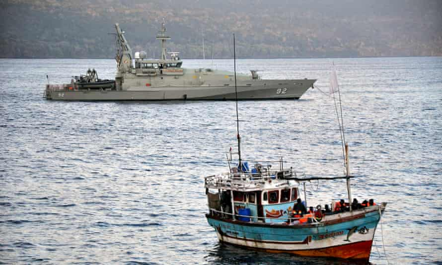 An Australian navy patrol boat escorting an asylum seeker vessel to Christmas Island.