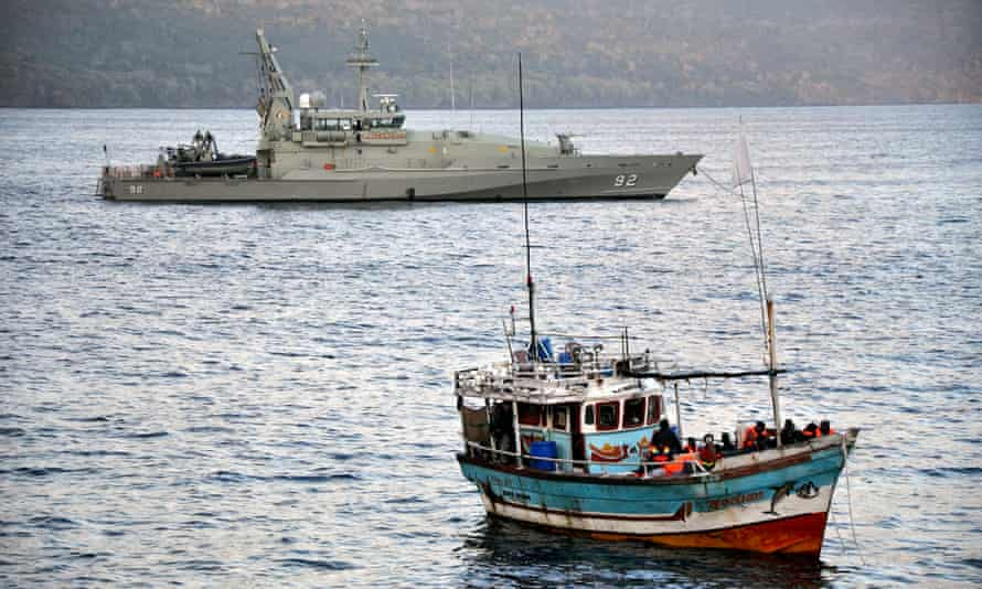 Asylum seekers arriving by boat are escorted by Australian navy patrol boats in 2012