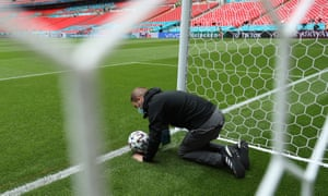 A member of staff conducts a test of the goal line technology system at Wembley.