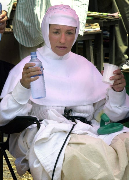 taking a break on set during the filming of Mother Teresa of Calcutta (2003).