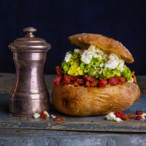 Baked potato with avocado, lime, chilli, feta and smoked bacon, by Peter Gordon. 20 best meals for one. Food stylist Polly Webb-Wilson.