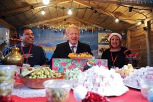 Boris Johnson visits a Christmas market in Salisbury.