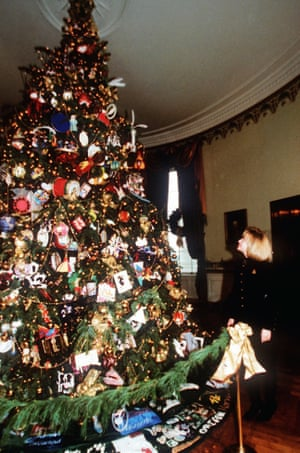 1994 - First lady Hillary Rodham Clinton looks over the White House Christmas Tree in the Blue Room of the White House.