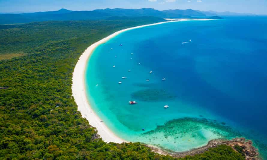 turquoise water, white sand beach and bushland