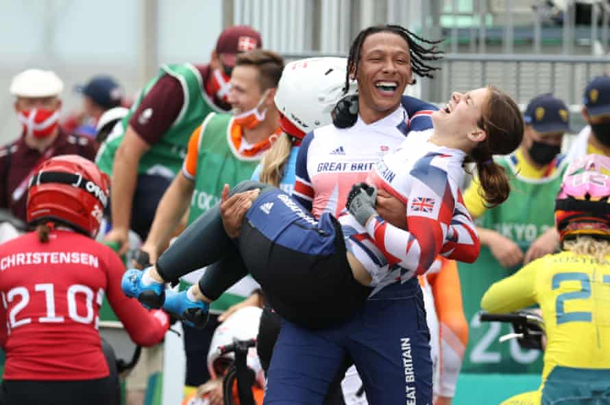 Kye Whyte lifts Bethany Shriever after their Olympic success.
