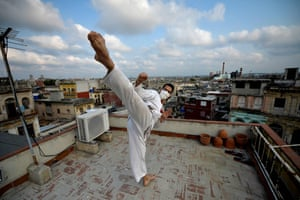 Cuban martial artist Alejandro Lopez on the roof of his home in Havana.