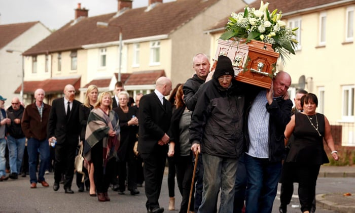 Friends and family carry the remains of one Seamus Wright.