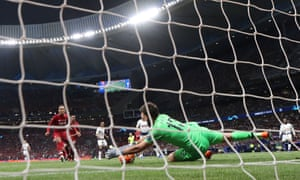 Liverpool's Alisson saves a shot from Tottenham's Lucas Moura.