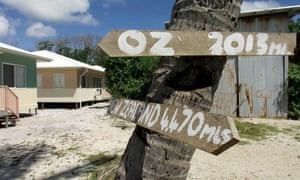 Signs pointing the way to Australia and New Zealand in Anaoe village on Nauru