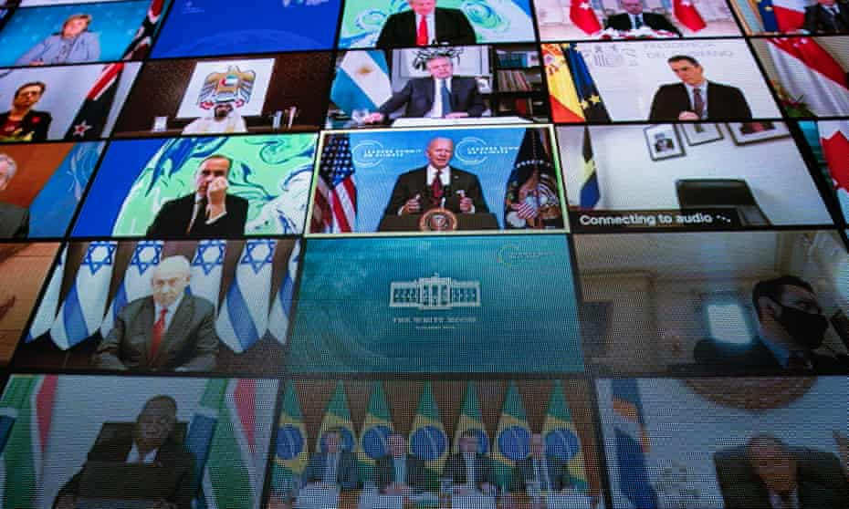 World leaders are seen remotely on a screen as US President Joe Biden delivers remarks during a virtual leaders summit.