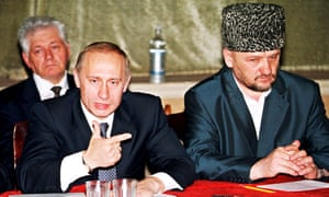 Vladimir Putin with the then head of Chechnya's pro-Moscow administration, Akhmad Kadyrov, in July 2000.