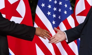 President Donald Trump, right, reaches to shake hands with North Korea leader Kim Jong-un at the Capella resort on Sentosa Island in Singapore.
