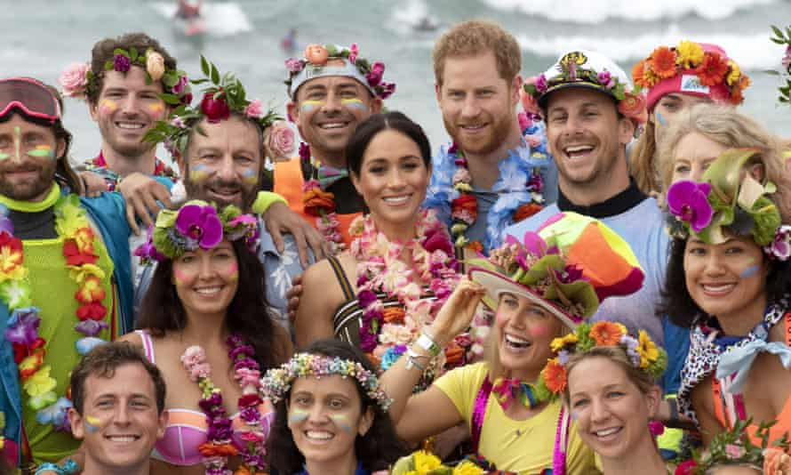 Harry and Meghan with members of OneWave