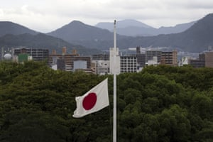 The Japanese national flag flies at half-mast