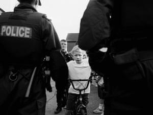 Carrick Hill: Brendan behind a police line on Trinity Street, 2017