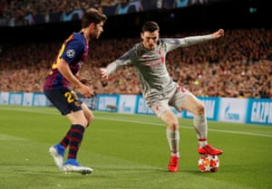 Liverpool's Andrew Robertson in action with Barcelona's Sergi Roberto.