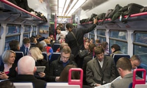 A crowded Great Western commuter train from Henley on Thames to London Paddington.