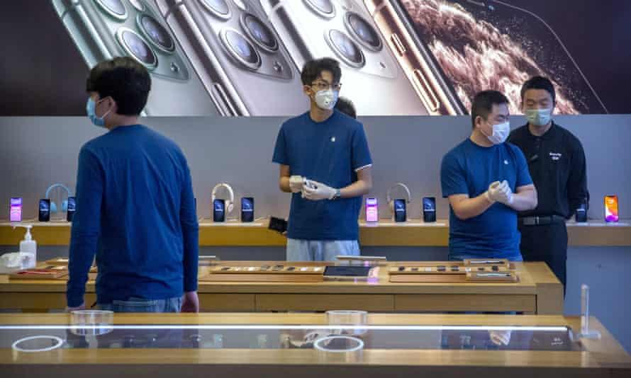 Workers in an Apple store in Beijing.