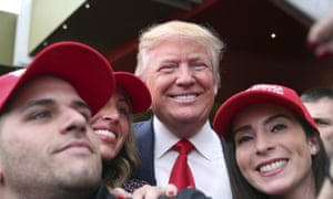 Donald Trump, Pat Montelli, Catherine FreemanSupporter Pat Montelli, left and friend Catherine Freeman, right, take a photograph with Republican presidential candidate, Donald Trump at a campaign rally Sunday, April 17, 2016, in Staten Island, N.Y. (AP Photo/Mel Evans)
