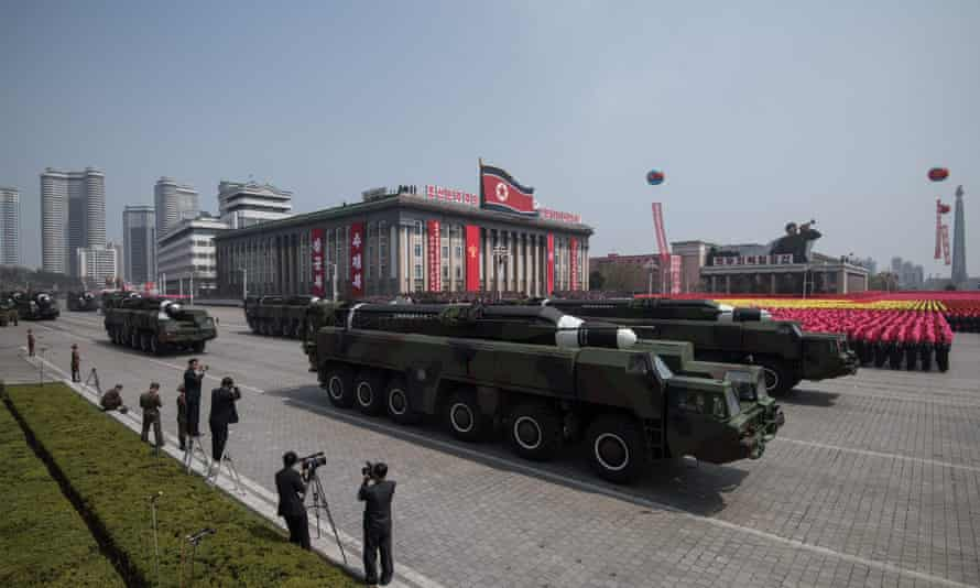 A north korea missile and mobile launcher making its way through Kim Il-Sung Square during a military parade
