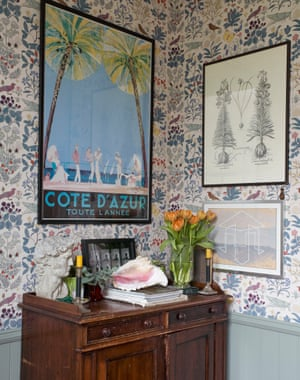 Floral wallpaper in the bathroom of the London home of interior designers and artists Luke Edward Hall and Duncan Campbell