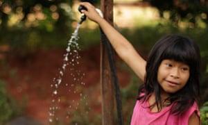 girl paraguay water rural