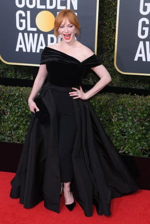 Christina Hendricks, whose Naeem Khan gown was remade in black from gold when the dress code was announced, arrives on the red carpet.