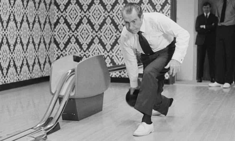 Richard Nixon approaches the foul line.