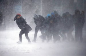 People struggle to walk against the wind in Boston