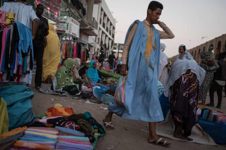 Haratine women sell fabric in the main market in the centre of Nouakchott