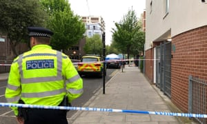 Police at the scene of the first stabbing on Frampton Park Road in Hackney, London.