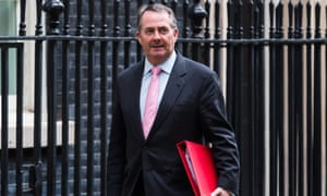 Trade secretary Liam Fox leaves the UK cabinet meeting on budget day at Downing Street.